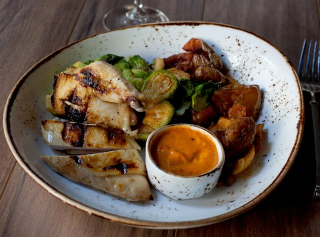Half Chicken, Fried Fingerlings and Brussels by Chef Jason Wilson